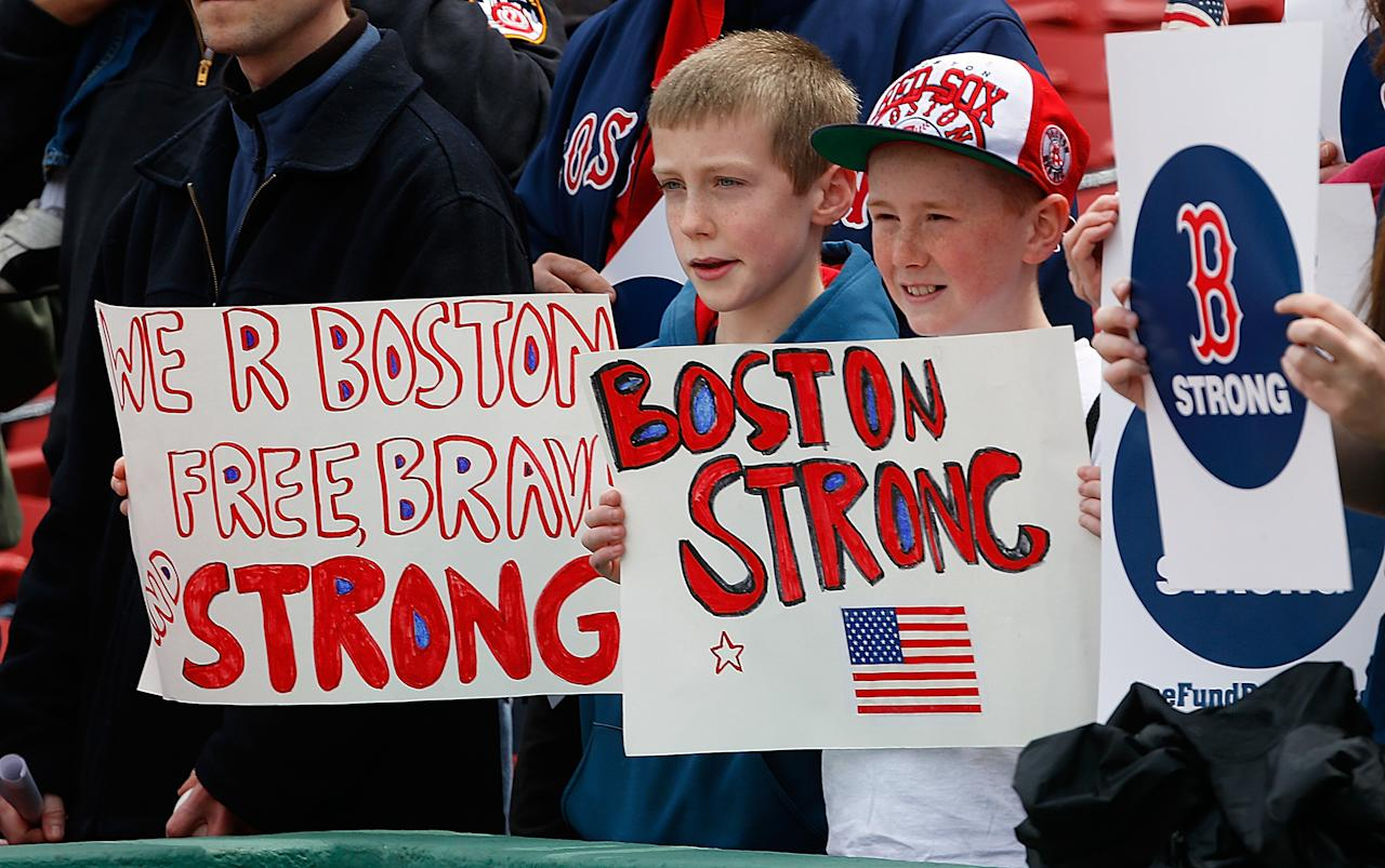 BOSTON, MA - APRIL 20: Fans hold a sign to honor the Marathon bombing victims, before a game the Kansas City Royals at Fenway Park on April 20, 2013 in Boston, Massachusetts.  (Photo by Jim Rogash/Getty Images)