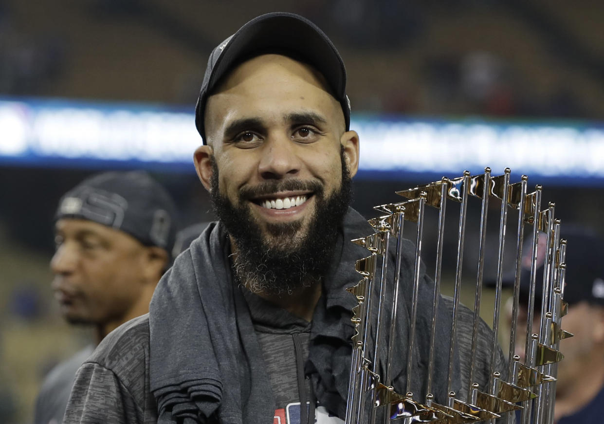 Boston Red Sox pitcher David Price holds the championship trophy after Game 5 of baseball's World Series against the Los Angeles Dodgers on Oct. 28, 2018, in Los Angeles. The Red Sox won 5-1 to win the series 4-1. (AP Photo/David J. Phillip)