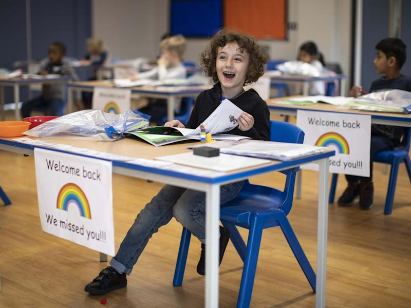Children sit at individual desks during a lesson at the Harris Academy's Shortland's school on June 04, 2020: Getty Images