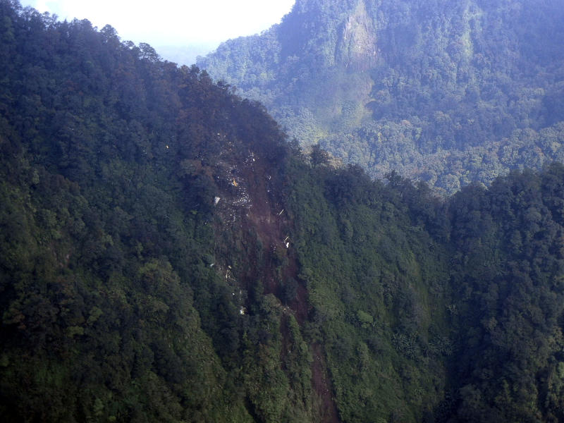 In this photo released by Indonesian Air Force, the wreckage of a missing Sukhoi Superjet-100 are scattered on the mountainside in Bogor, West Java, Indonesia, Thursday, May 10, 2012. The new Russian-made passenger plane disappeared Wednesday during a demonstration flight with 47 people on board. (AP Photo/Indonesian Air Force)