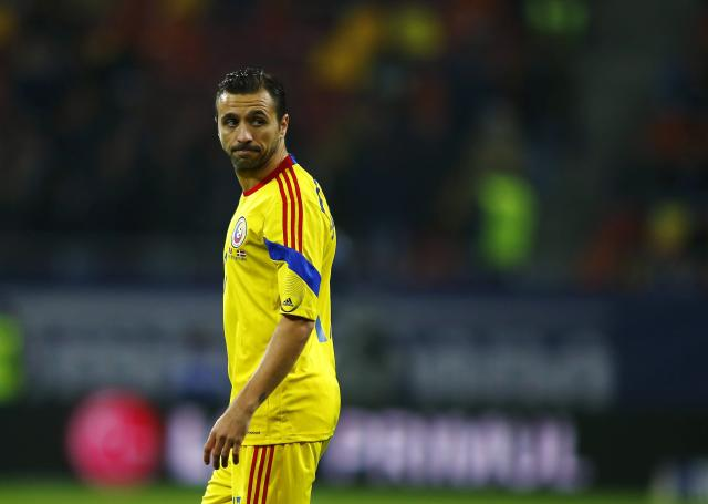 Romania's Lucian Sanmartean looks on during their international friendly soccer match against Denmark at National Arena in Bucharest November 18, 2014. Romania have reaped the rewards of a rejuvenated Sanmartean after the veteran returned following a three-year break to become instrumental in guiding the team to the top of their Euro 2016 qualifying group. The 34-year-old midfielder was named in Romania's starting lineup for the eagerly-anticipated clash with neighbours Hungary last month, his first international appearance since playing 28 minutes of a Euro 2012 qualifier against Belarus on October 7, 2011. REUTERS/Bogdan Cristel (ROMANIA - Tags: SPORT SOCCER)