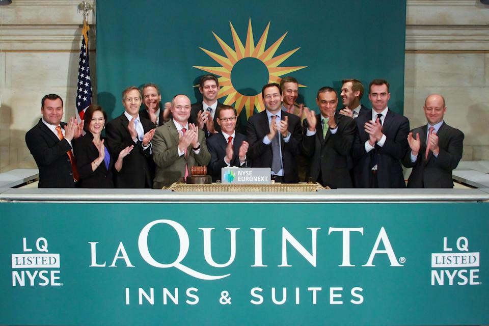 FILE - In this Wednesday, April 9, 2014 file photo released by the New York Stock Exchange, executives and guests of La Quinta Holdings applaud the opening bell in honor of the company's IPO. So far in 2014, IPOs are having their best start to a year since 2000, with 89 companies raising $19 billion through sales of new stock. But demand for more offerings depends largely on the health of the broader market, and after last week's sell-off, the clamor from buyers may quiet down. (AP Photo/NYSE Euronext, Ben Hider, File)