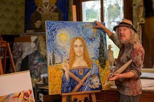 """Wolfgang Beltracchi standing in front of a re-creation of the """"Salvator Mundi"""" in the style of Vincent van Gogh (Image by: Alberto Venzago)"""