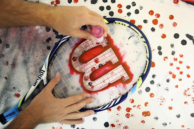 LONDON, ENGLAND - JULY 03: Wilson brand logo is stenciled on a players racket on day eight of the Wimbledon Lawn Tennis Championships at the All England Lawn Tennis and Croquet Club on July 3, 2012 in London, England. (Photo by Dan Kitwood/Getty Images)