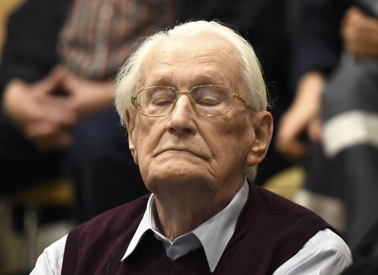 "Oskar Groening, defendant and former Nazi SS officer dubbed the ""bookkeeper of Auschwitz"", listens to the verdict during his trial in Lueneburg, Germany, July 15, 2015. The 94-year-old German man who worked as a bookkeeper at the Auschwitz death camp was convicted on Wednesday of being an accessory to the murder of 300,000 people and was sentenced to four years in prison, in what could be one of the last big Holocaust trials, Lueneburg, Germany, July 15, 2015. REUTERS/Axel Heimken/Pool"
