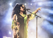 """FILE - This April 14, 2019 file photo shows H.E.R. performing at the Coachella Music & Arts Festival in Indio, Calif. H.E.R. will perform during the """"In Memoriam"""" segment at the Emmy Awards on Sunday. (Photo by Amy Harris/Invision/AP, File)"""
