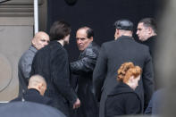 """Colin Farrell, centre, who plays the Penguin, is seen alongside star Robert Pattinson, second left, during filming of """"The Batman"""" at St. George's Hall in Liverpool's city center, England, Tuesday, Oct. 13, 2020. The production had a break in filming after the star of the movie Robert Pattinson reportedly testing positive for the virus last month. (AP Photo/Jon Super)"""