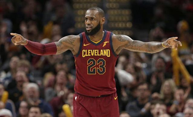 "<a class=""link rapid-noclick-resp"" href=""/nba/players/3704/"" data-ylk=""slk:LeBron James"">LeBron James</a> hit a buzzer-beater over <a class=""link rapid-noclick-resp"" href=""/nba/players/5294/"" data-ylk=""slk:Joel Embiid"">Joel Embiid</a> at the end of the first half on Monday. (AP)"