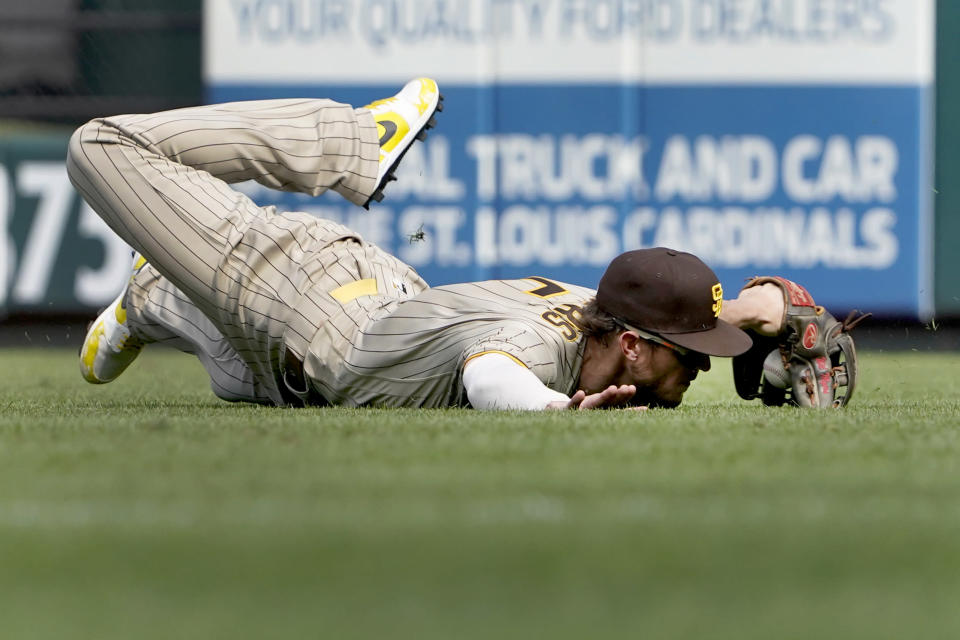 San Diego Padres right fielder Wil Myers is unable to catch and RBI double by St. Louis Cardinals' Edmundo Sosa during the fifth inning of a baseball game Sunday, Sept. 19, 2021, in St. Louis. (AP Photo/Jeff Roberson)