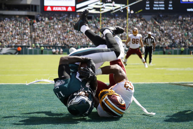 Philadelphia Eagles' Alshon Jeffery, left, hangs onto a touchdown pass against Washington Redskins' Jon Bostic during the second half of an NFL football game Sunday, Sept. 8, 2019, in Philadelphia. (AP Photo/Matt Rourke)