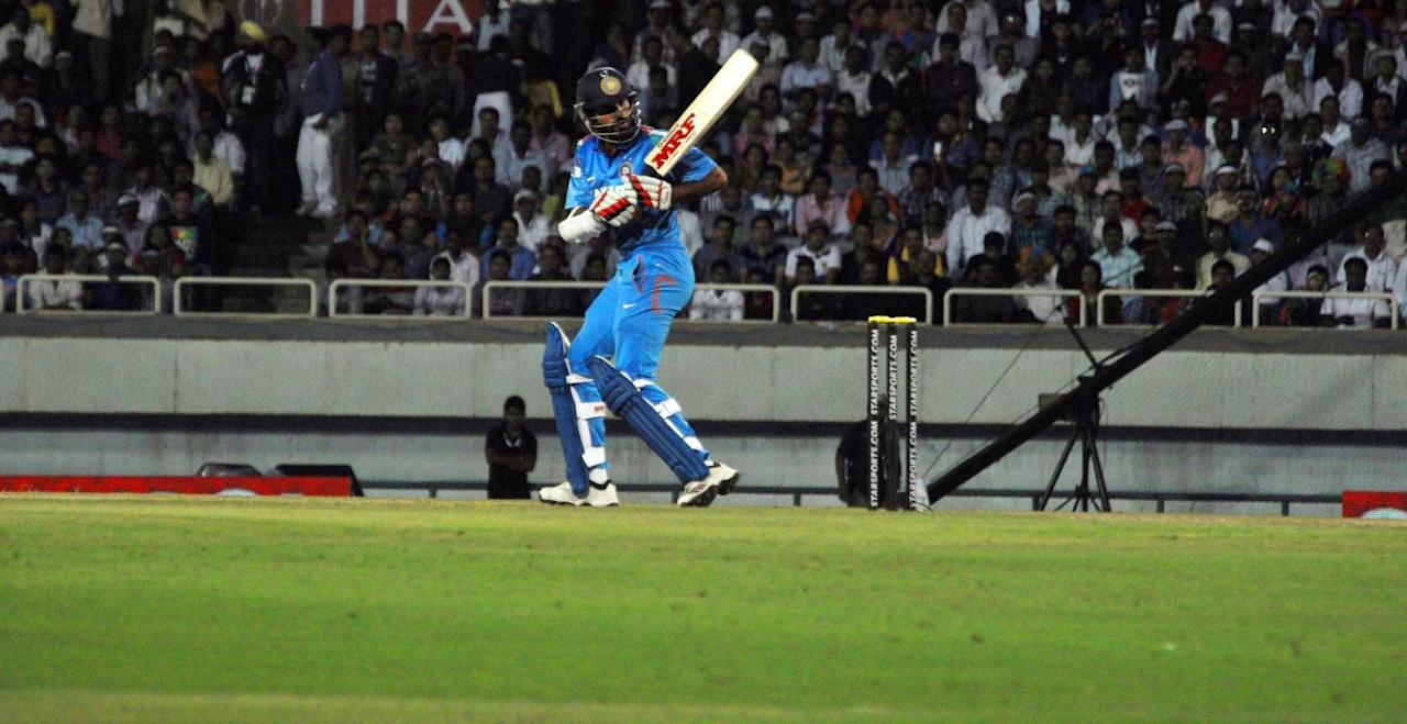 Indian batsman Shikhar Dhawan in action during the 4th ODI between India and Australia at JSCA Stadium in Ranchi on Oct. 23, 2013. (Photo: IANS)