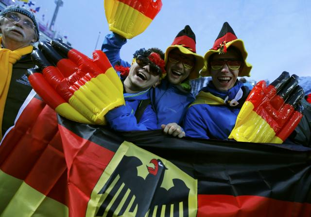 German fans cheer during the women's freestyle skiing moguls qualification round at the 2014 Sochi Winter Olympic Games in Rosa Khutor, February 8, 2014. REUTERS/Mike Blake (RUSSIA - Tags: SPORT SKIING OLYMPICS)