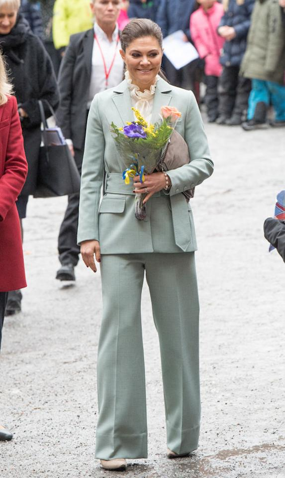 <p>Just in case you needed a closer look at Crown Princess Victoria's lustworthy mint suit, here's a snap of the royal on day two. She teamed the Rodebjer suit with a ruffled shirt and Stella McCartney clutch. <em>[Photo: Getty]</em> </p>