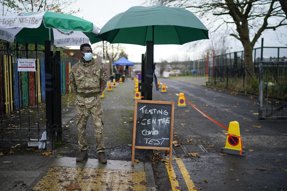 LIVERPOOL, ENGLAND - NOVEMBER 11: A soldier from the 1st battalion Coldstream Guards greets members of the public at a coronavirus testing centre set up at the Merseyside Caribbean Council Community Centre on November 11, 2020 in Liverpool, England. More than 23,000 people had been tested for covid-19 in the first three days of the city's mass testing trial. In that time, 154 people tested positive. All residents and workers in the city were offered the test. (Photo by Christopher Furlong/Getty Images)