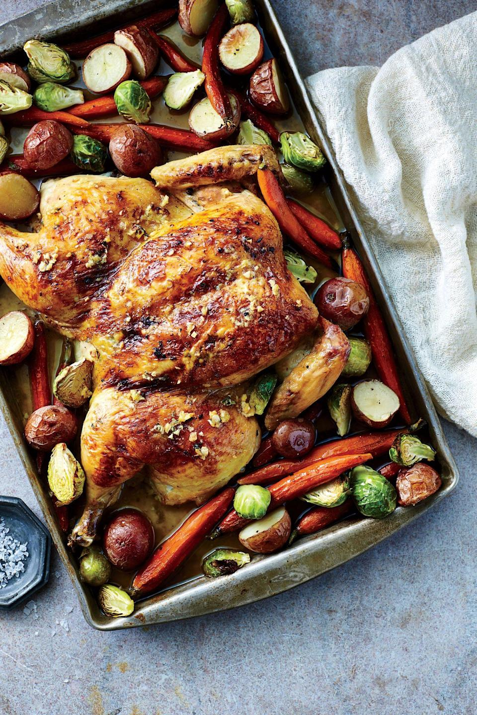 """<p><strong>Recipe: <a href=""""https://www.southernliving.com/recipes/roast-spatchcock-chicken"""" rel=""""nofollow noopener"""" target=""""_blank"""" data-ylk=""""slk:Roasted Spatchcock Chicken"""" class=""""link rapid-noclick-resp"""">Roasted Spatchcock Chicken</a></strong></p> <p>If you find roasting a whole chicken intimidating, this sheet pan recipe will help you achieve the ideal crispiness without over-drying the meat. </p>"""