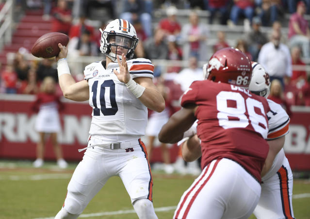 Auburn quarterback Bo Nix throws a pass against Arkansas during the first half of an NCAA college football game, Saturday, Oct. 19, 2019 in Fayetteville, Ark. (AP Photo/Michael Woods)