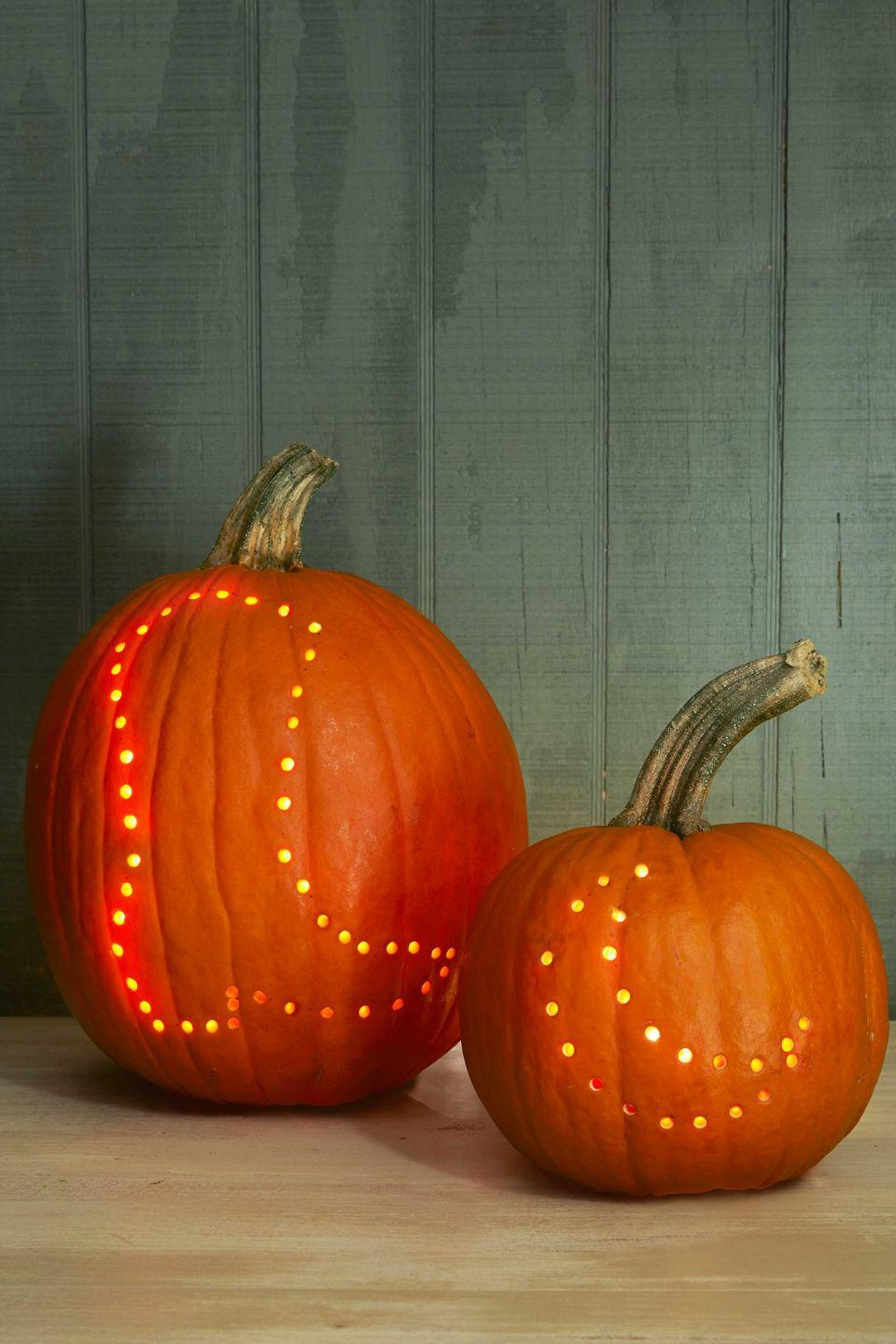 """<p>With drilled (rather than carved) pumpkins, your life is bound to be a <em>hole</em> lot easier. To make these fun designs, simply cut a hole in the bottom of a large pumpkin, then scoop out the pulp and seeds as you normally would. Next, mark your desired pattern with an erasable wax pencil. Using a medium drill bit, punch out a dotted outline of your image. Leave approximately the same amount of space between each hole, and you're good to go!</p><p><strong><a href=""""http://clv.h-cdn.co/assets/cm/15/24/5578ad543ea0b_-_Pumpkins.pdf"""" rel=""""nofollow noopener"""" target=""""_blank"""" data-ylk=""""slk:Get the template."""" class=""""link rapid-noclick-resp"""">Get the template.</a> </strong> </p>"""