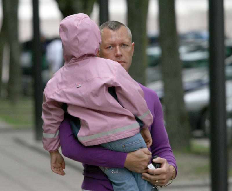 In this photo made in June, 2009, Drasius Kedys is pictured with his daughter, Deimante Kedys, in Lithuania.  Kedys claimed his daughter was being abused by a pedophile ring involving the girl's mother and including judges and politicians that he claimed preyed on his then 5-year-old daughter. After a complicated series of events Drasius Kedys was found dead under mysterious circumstances two years ago. Kedys' funeral was attended by thousands of Lithuanians who had come to regard him as a martyr who dared fight an allegedly corrupt justice system. (AP Photo/Modestas Patasius) Eds note: photo dated June, 2009.