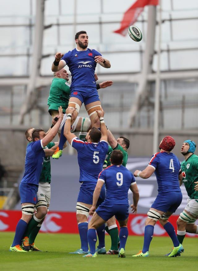 Ireland's Rhys Ruddock (left) and France's Charles Ollivon contest a line-out at the Aviva Stadium
