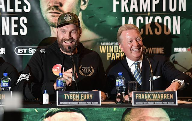 Legendary Hall of Fame promoter Frank Warren (R) shares a laugh with ex-heavyweight champion Tyson Fury on Aug. 14 at a news conference in Belfast, Northern Ireland. (Getty Images)