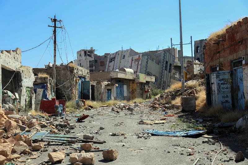 Rubble and debris are strewn in the streets of Taez, the capital of the Taez province, after clashes between Shiite Huthi rebels and pro-government militants on November 22, 2016