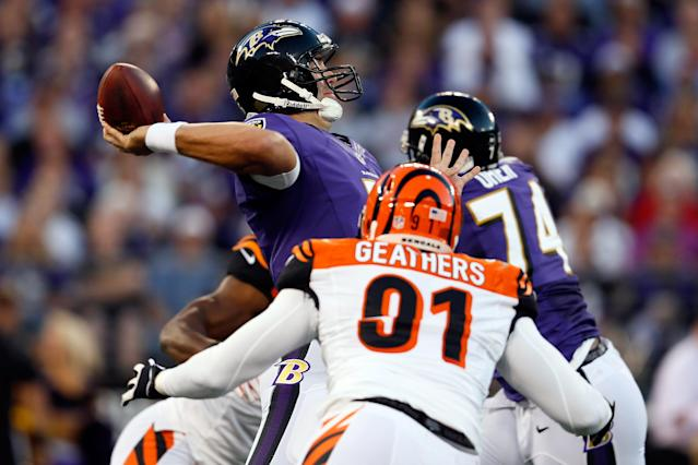 BALTIMORE, MD - SEPTEMBER 10: Quarterback Joe Flacco #5 of the Baltimore Ravens passes the ball in the first half as defensive end Robert Geathers #91 of the Cincinnati Bengals rushes in at M&T Bank Stadium on September 10, 2012 in Baltimore, Maryland. (Photo by Rob Carr/Getty Images)
