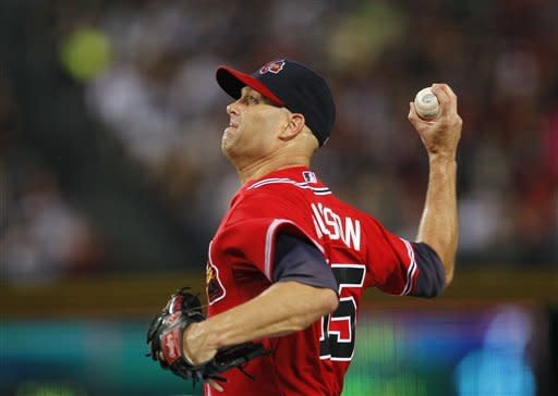 Atlanta Braves starting pitcher Tim Hudson (15) works in the third inning of a baseball game against the New York Mets in Atlanta, Friday, Sept. 28, 2012. (AP Photo/John Bazemore)