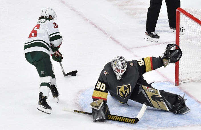 LAS VEGAS, NEVADA - APRIL 01: Robin Lehner #90 of the Vegas Golden Knights saves a shot by Mats Zuccarello #36 of the Minnesota Wild in a shootout at T-Mobile Arena on April 01, 2021 in Las Vegas, Nevada. (Photo by Jeff Bottari/NHLI via Getty Images)