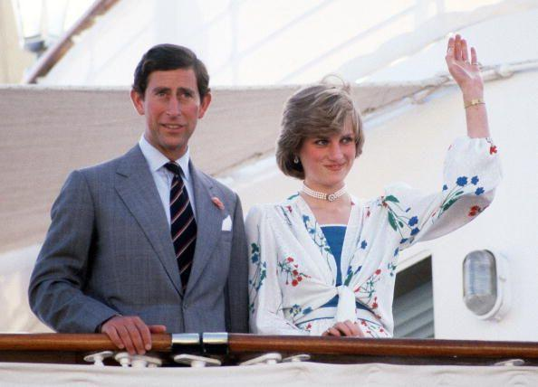<p>Right before heading out on a 12-day honeymoon cruise, the new Princess waves to admirers from the Royal Yacht Britannia on July 31, 1981.</p>