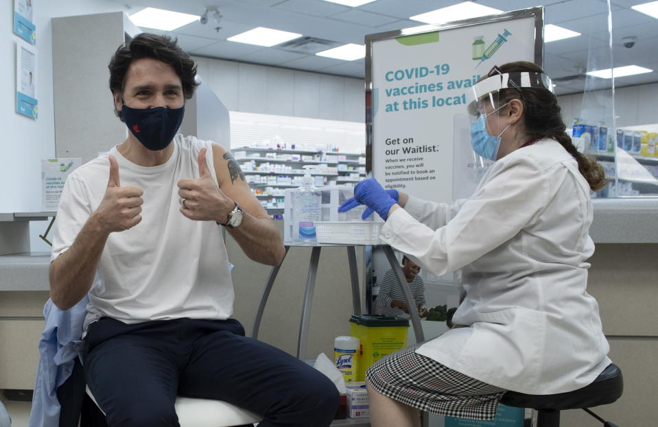 Prime Minister Justin Trudeau gives the thumbs up after receiving his COVID-19 AstraZeneca vaccination in Ottawa on Friday April 23, 2021. (Adrian Wyld/The Canadian Press via AP)