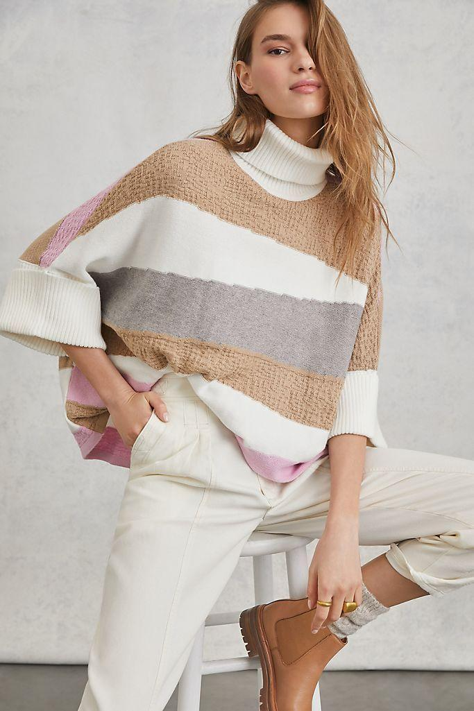 """<p><strong>Callahan Anthropologie</strong></p><p>anthropologie.com</p><p><strong>$138.00</strong></p><p><a href=""""https://go.redirectingat.com?id=74968X1596630&url=https%3A%2F%2Fwww.anthropologie.com%2Fshop%2Fmichelle-poncho-sweater&sref=https%3A%2F%2Fwww.thepioneerwoman.com%2Fholidays-celebrations%2Fgifts%2Fg33985357%2Fbest-gifts-for-mom%2F"""" rel=""""nofollow noopener"""" target=""""_blank"""" data-ylk=""""slk:Shop Now"""" class=""""link rapid-noclick-resp"""">Shop Now</a></p><p>Quiet colors and loads of texture make this blouse stand out. It'll add a much-needed splash of joy to her holiday celebrations in 2020.</p>"""