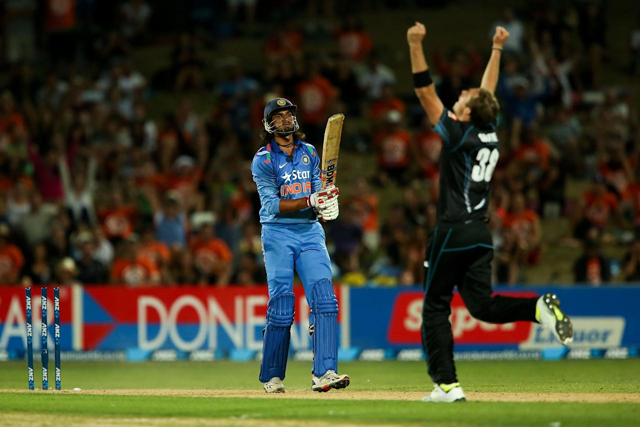 NAPIER, NEW ZEALAND - JANUARY 19:  Tim Southee of New Zealand celebrates after taking the wicket of Ishant Sharma of India during the first One Day International match between New Zealand and India at McLean Park on January 19, 2014 in Napier, New Zealand.  (Photo by Hagen Hopkins/Getty Images)