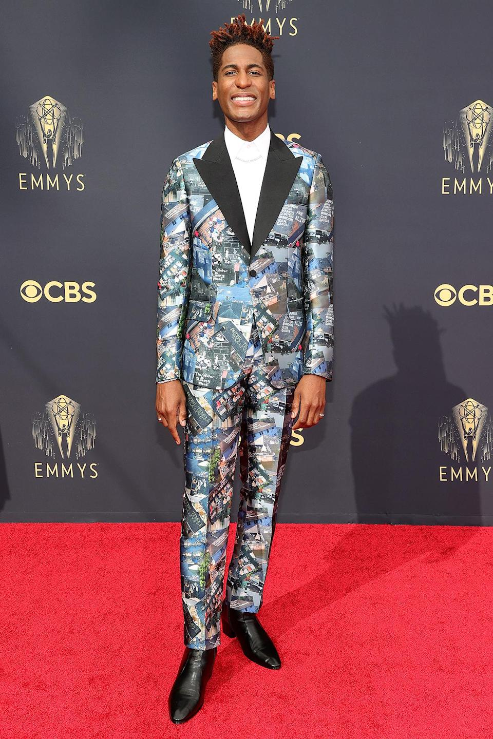 <p>Batiste made a statement with his tux, which was created from a fabric featuring photos of climate devastation.</p>