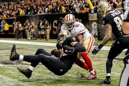 Nov 9, 2014; New Orleans, LA, USA; New Orleans Saints tight end Jimmy Graham (80) catches the ball in front of San Francisco 49ers strong safety Antoine Bethea (41) but is flagged for offensive pass interference negating a touchdown on the final play in the fourth quarter at Mercedes-Benz Superdome. The 49ers won 27-24 in overtime. Mandatory Credit: Derick E. Hingle-USA TODAY Sports