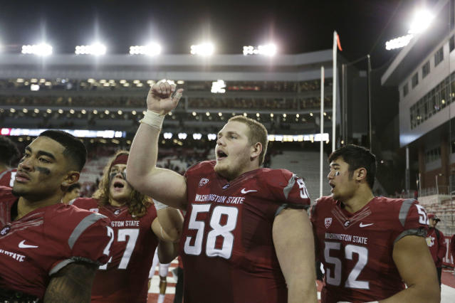 "Washington State safety <a class=""link rapid-noclick-resp"" href=""/ncaaf/players/240322/"" data-ylk=""slk:Robert Taylor"">Robert Taylor</a> (2), linebacker <a class=""link rapid-noclick-resp"" href=""/ncaaf/players/230648/"" data-ylk=""slk:Peyton Pelluer"">Peyton Pelluer</a> (47) offensive lineman Riley Sorenson (58) and defensive lineman Kingston Fernandez (52) celebrate after an NCAA college football game against California in Pullman, Wash., Saturday, Nov. 12, 2016. (AP Photo/Young Kwak)"