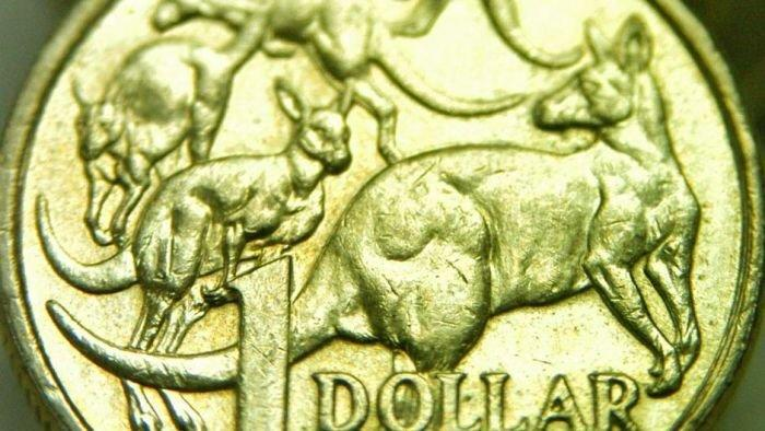 Aussie dollar surges on cliff deal, but 10c fall forecast
