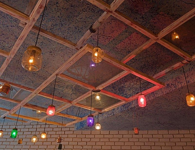 Window frames with glass/mason jars suspended with lights inside them.