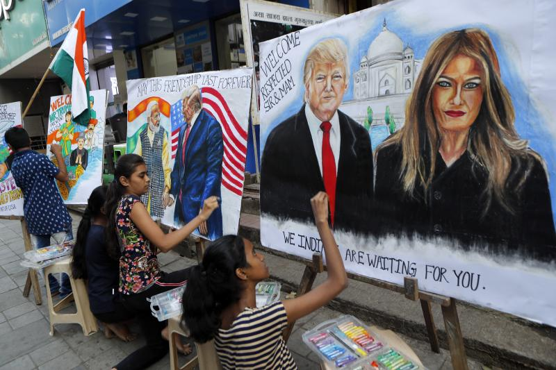 Children from an art school make paintings of U.S. President Donald Trump ahead of his India visit, in Mumbai, India, Friday, Feb. 21, 2020. Trump is scheduled to visit India Feb. 24-25. (AP Photo/Rajanish Kakade)