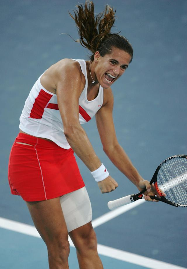 ATHENS - AUGUST 19: Amelie Mauresmo of France celebrates her win over Svetlana Kuzentsova of Russia in the women's singles tennis quarterfinal match on August 19, 2004 during the Athens 2004 Summer Olympic Games at the Olympic Sports Complex Tennis Centre in Athens, Greece. (Photo by Clive Brunskill/Getty Images)