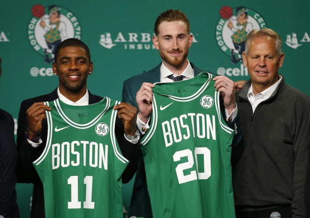 "Kyrie Irving and <a class=""link rapid-noclick-resp"" href=""/nba/players/4724/"" data-ylk=""slk:Gordon Hayward"">Gordon Hayward</a> hold up their new jerseys with Celtics team president Danny Ainge on Friday. (AP Photo/Winslow Townson)"