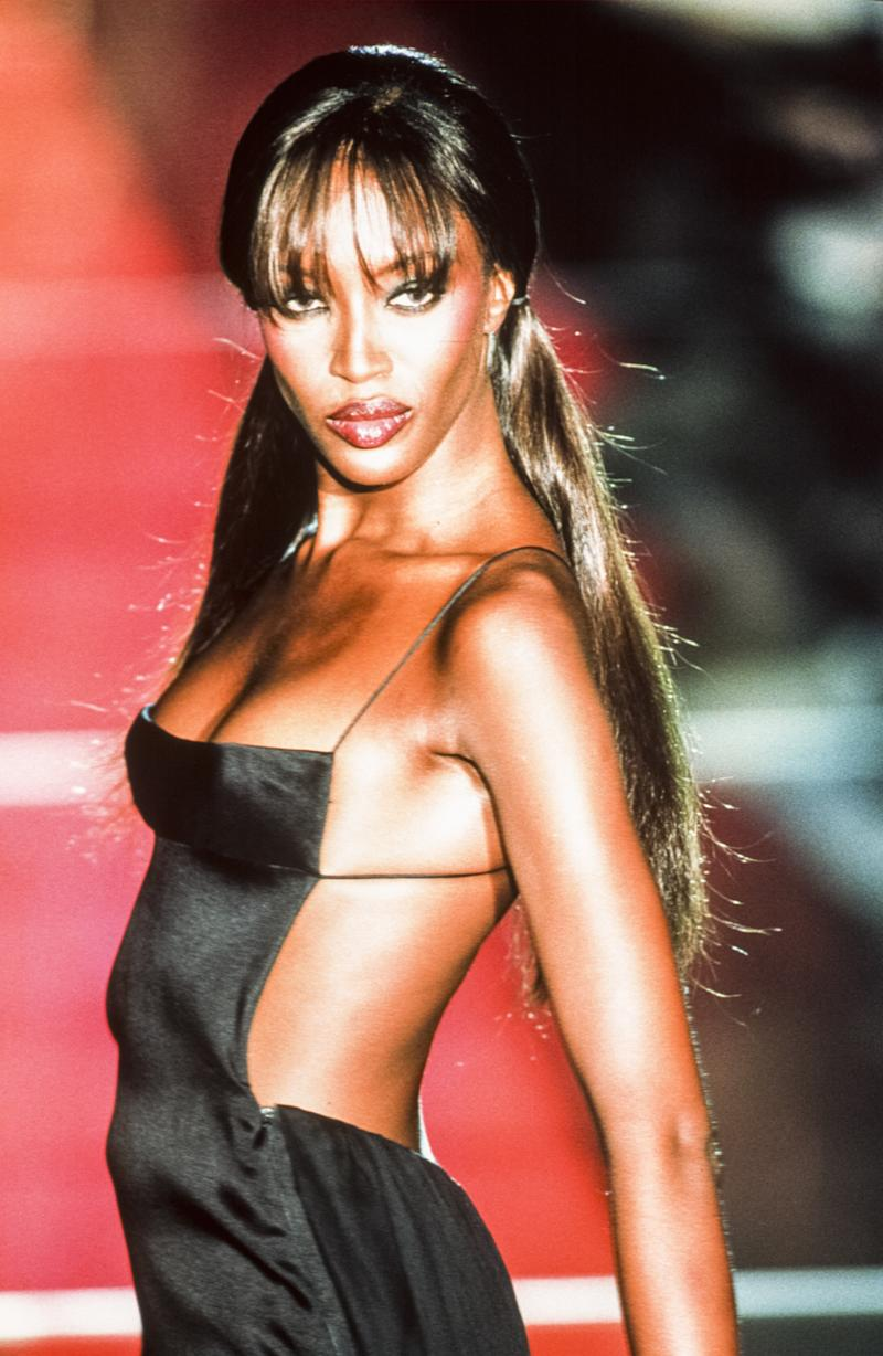 Naomi Campbell walks the runway of the Versace fall/winter 1999 couture show during Paris Fashion Week in 1999. Photo courtesy of Getty Images.