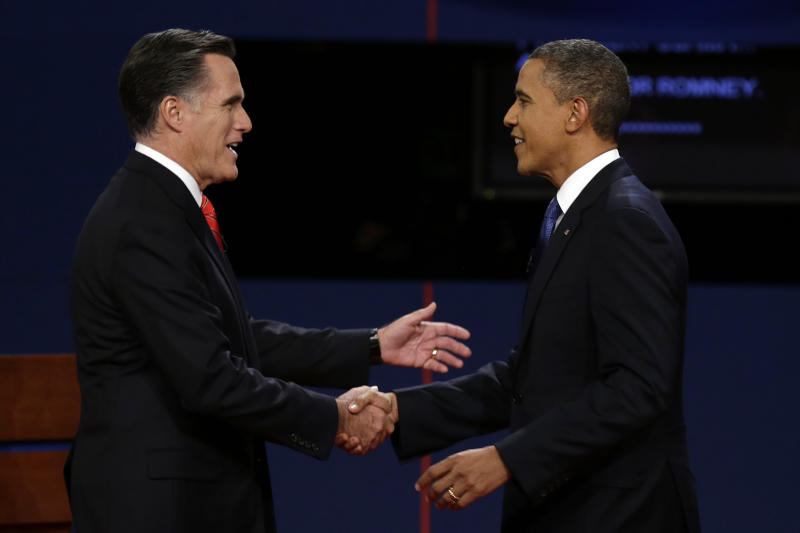 Republican presidential nominee Mitt Romney and President Barack Obama shake hands before the first presidential debate at the University of Denver, Wednesday, Oct. 3, 2012, in Denver. (AP Photo/Charlie Neibergall)