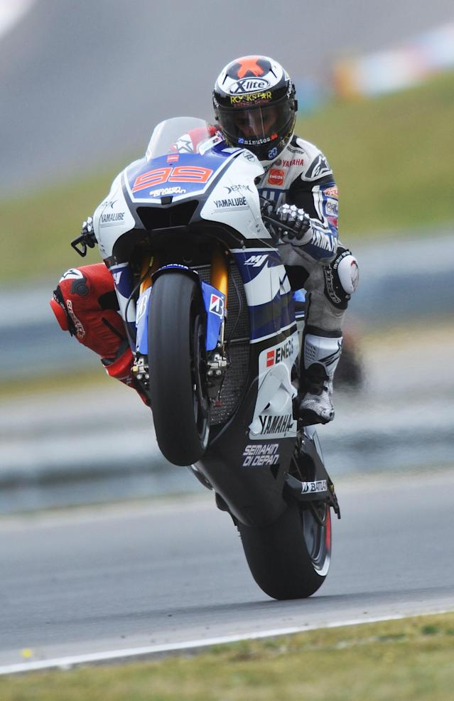 Spain's Jorge Lorenzo wheelies his Yamaha during the qualifying pratice session of the Czech Republic Grand Prix in Moto GP on August 25, 2012 in Brno ahead of the Grand prix on August 26. Lorenzo secured pole position ahead of Enlgand's Cal Crutchlow and Spain's Dani Pedrosa. AFP PHOTO/ MICHAL CIZEKMICHAL CIZEK/AFP/GettyImages
