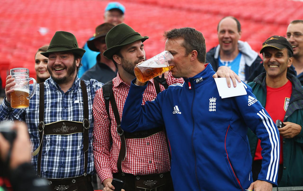 MANCHESTER, ENGLAND - AUGUST 05:  Graeme Swann of England celebrates with fans after England retained the Ashes during day five of the 3rd Investec Ashes Test match between England and Australia at Emirates Old Trafford Cricket Ground on August 5, 2013 in Manchester, England.  (Photo by Michael Steele/Getty Images)