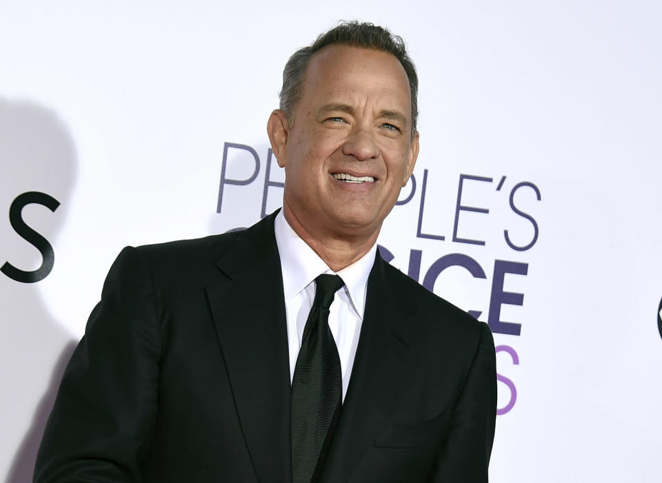FILE - In this Wednesday, Jan. 18, 2017, file photo, Tom Hanks arrives at the People's Choice Awards at the Microsoft Theater in Los Angeles. Hanks will host a 90-minute primetime TV special celebrating the inauguration of Joe Biden as president of the United States. (Photo by Jordan Strauss/Invision/AP, File)