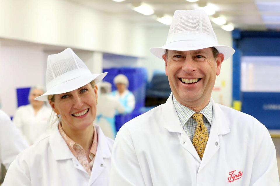 <p>Sophie, Countess of Wessex and Prince Edward wear some striking hats during a visit to the Tiptree Jam Factory. </p>