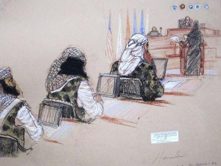Ramzi, Walid bin Attash and Khalid Sheikh Mohammad, three of the alleged conspirators in the 9/11 attacks, attend court dressed in camouflage during hearings in Guantanamo Bay