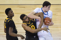 Creighton's Ryan Kalkbrenner pulls in a rebound next to Kennesaw State's Alex Peterson, center, and Brandon Stroud during the first half of an NCAA college basketball game in Omaha, Neb., Friday, Dec. 4, 2020. (AP Photo/Kayla Wolf)