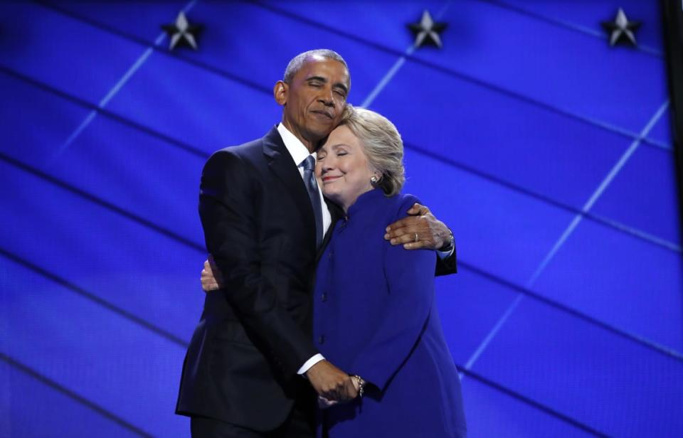 "<div class=""inline-image__caption""><p>Democratic presidential nominee Hillary Clinton hugs U.S. President Barack Obama as she arrives onstage at the end of his speech on the third night of the 2016 Democratic National Convention in Philadelphia, Pennsylvania, U.S., July 27, 2016. </p></div> <div class=""inline-image__credit"">Jim Young/Reuters</div>"