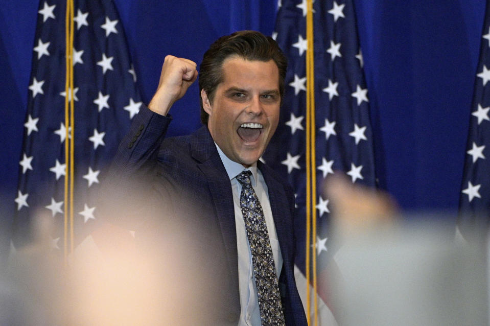 Rep. Matt Gaetz, R-Fla., cheers with attendees of a rally featuring himself and Rep. Marjorie Taylor Greene, R-Ga., Friday, May 7, 2021, in The Villages, Fla. (AP Photo/Phelan M. Ebenhack)